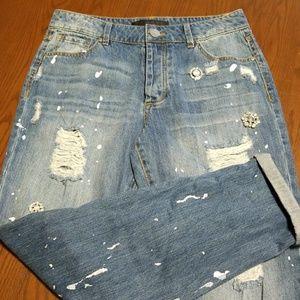 Tinsel ripped rhuestoned paint splatter jean NWOT